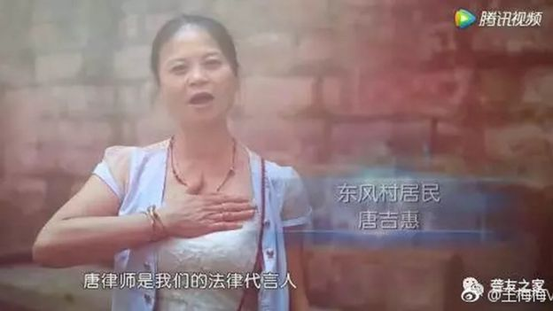 A deaf woman signs her gratefulness for Tang Shuai
