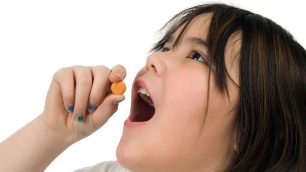girl taking vitamin C