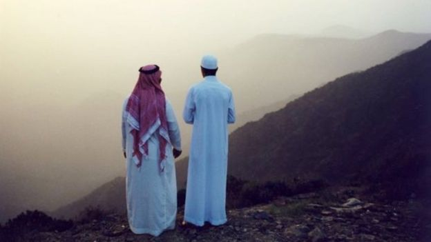 Men look out over Asir mountains
