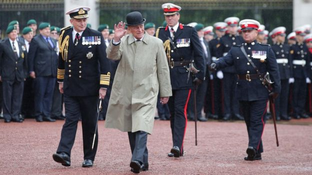 Prince Philip braved torrential rain outside Buckingham Palace