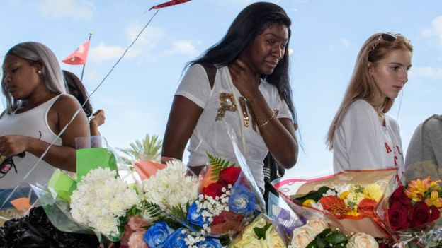 Fans mourn the death of musician XXXTentacion at a service in Florida