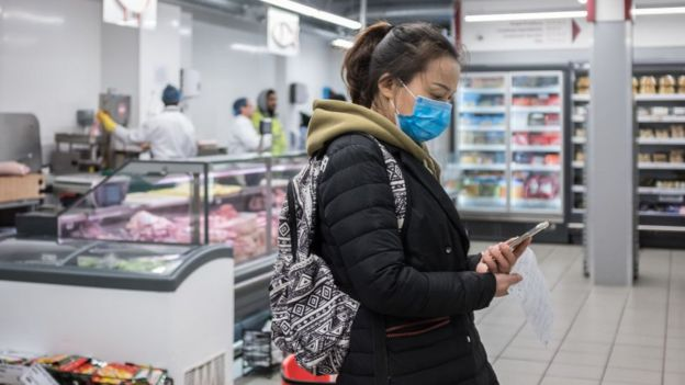 Woman wearing a facemask in a London supermarket