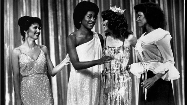 Miss Arkansas, Lencola Sullivan (C) and Miss Washington, Doris Janell Hayes (far R) give each other a glance after they became the first two Black women ever to win first place in the Miss America pageant. Arkansas won the swimsuit division and Washington split first with Miss Oklahoma, Susan Powell (far L) in the talent division.