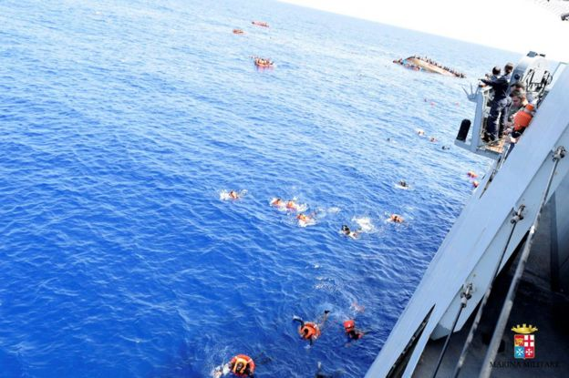 Migrants escape from a capsizing boat in the Mediterranean, 25 May