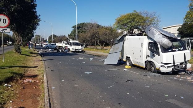 A picture showing a partially destroyed cash-in-transit van in Benoni