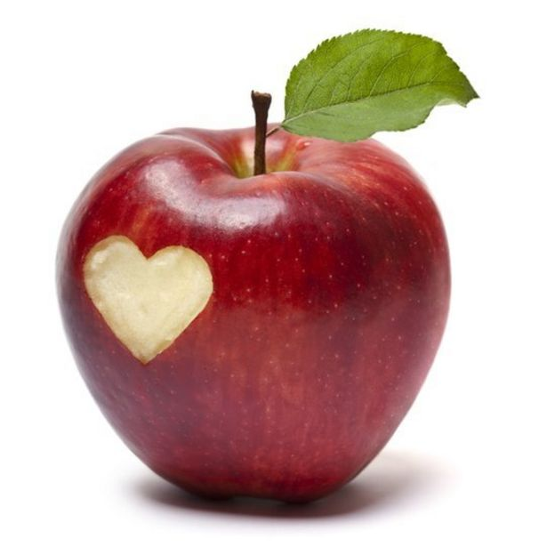 A red apple with a heart shape carved out
