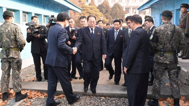 Head of the North Korean delegation Jon Jong-su, vice chairman of the Committee for the Peaceful Reunification of the Country (CPRC) of the DPRK, crosses the concrete border to attend his meeting with Southern counterparts at the truce village of Panmunjom in the demilitarised zone separating the two Koreas, South Korea, 17 January 2018