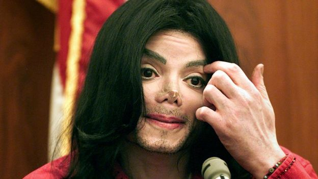 Michael Jackson sitting in the dock during a 2002 trial over cancellations of concert appearances