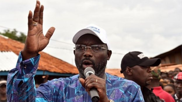 George Weah, addresses supporters during a campaign rally in Monrovia on October 8, 2017
