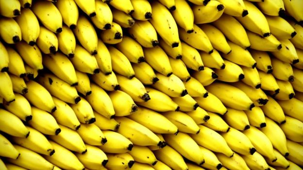 Bananas piled up in a market stall