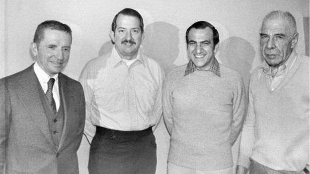 Ross Perot (L) with two of his employees and Col Arthur Simons (R) who commanded the Iran raid