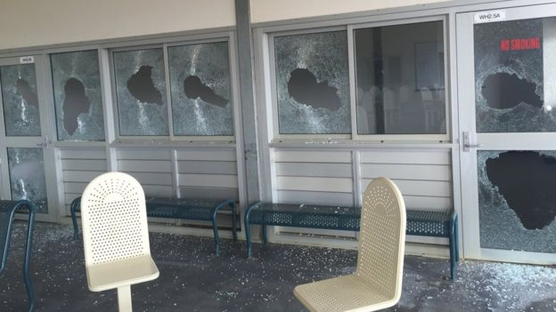 Photo of broken windows at Christmas Island detention centre
