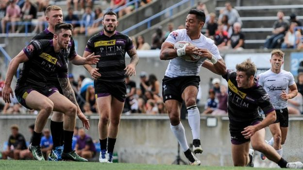 Toronto Wolfpack's Quentin Laulu-Togaga'e (in white)