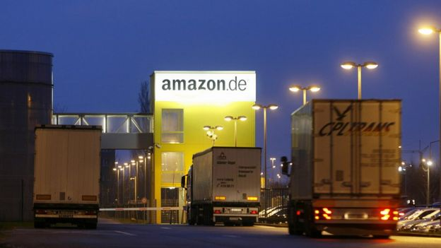 Trucks drive into the online retailer Amazon's distribution centre in the eastern German city of Leipzig