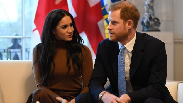 Meghan and Harry gesture during their visit to Canada House in thanks for the warm Canadian hospitality and support they received during their recent stay in Canada,