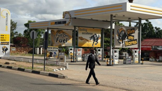 Man walks past a gas station in Harare, Zimbabwe, January 21, 2019
