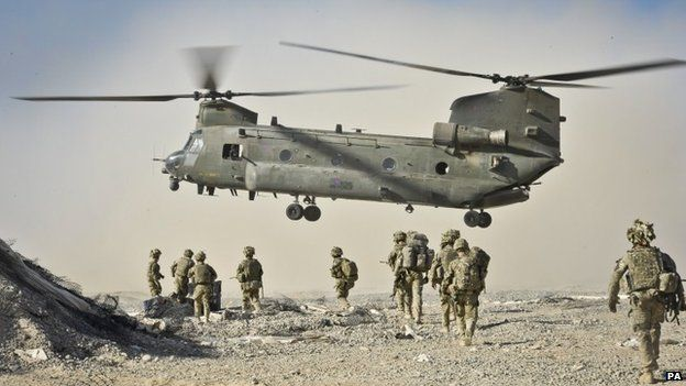 British soldiers approach a Chinook helicopter in Helmand Province, Afghanistan