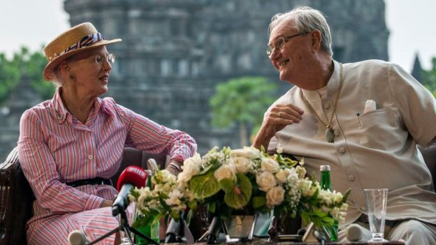 In this file photo taken on October 24, 2015 Danish Queen Margrethe II (L) and Prince Consort Henrik (R) visit the Prambanan temple during their visit to Yogyakarta