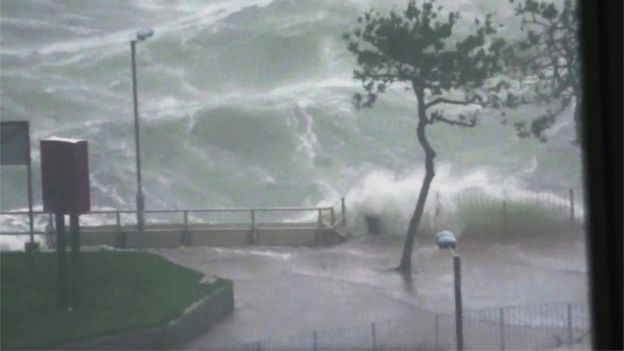 Waves crashed against the Hung Hom Promenade in Hong Kong during Typhoon Mangkhut, 16 September 2018