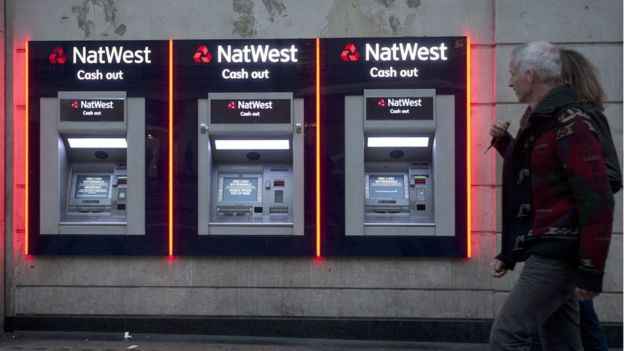 This picture shows people walking past a branch of a NatWest Bank in London
