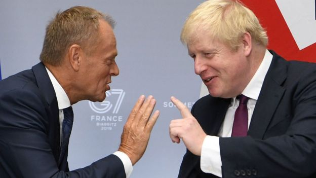 Boris Johnson y el presidente del Consejo Europeo, Donald Tusk.