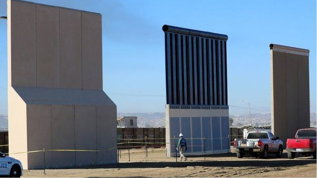 """Three of U.S. President Donald Trump""""s eight border wall prototypes are shown near completion along U.S.- Mexico border in San Diego"""