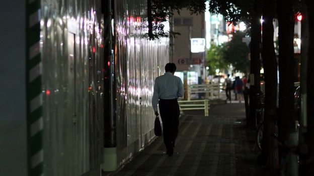 A businessman walking on a street in Tokyo