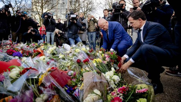 Dutch PM Mark Rutte and Justice Minister Ferdinand Grapperhaus (2nd R) laid flowers close to the scene of the attack