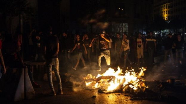 Protesters in Beirut burn tires near the presidential palace