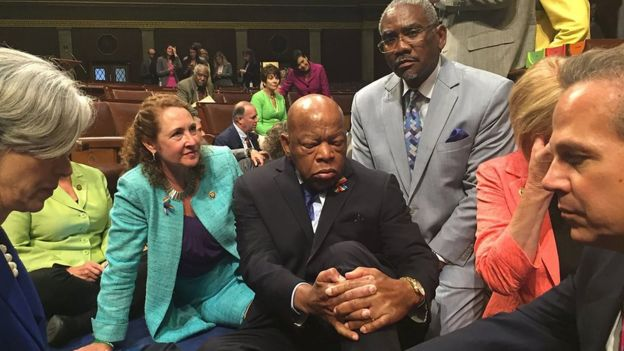 This image courtesy of Democratic Rep. Elizabeth Sty's office shows Rep. Esty (2nd-L) with Rep. John Lewis (C) and other members of Congress staging a sit-in on the floor of the US House of Representatives on June 22, 2016 in Washington, DC