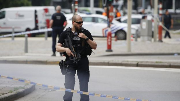 An armed policeman stands guard at the scene following a shooting in Liege, Belgium, 29 May 2018