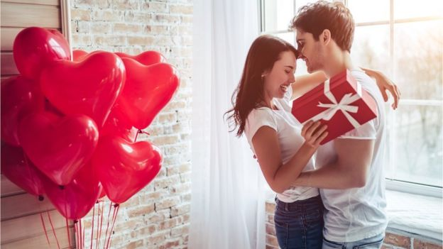Couple, gift and balloons