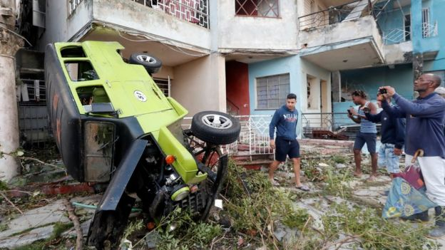 A car dropped outside an apartment in Havana where the storm struck
