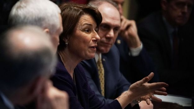 U.S. Sen. Amy Klobuchar (D-MN) (L) speaks as House Majority Whip Rep. Steve Scalise (R-LA) (R) listens during a meeting with President Donald Trump at the Cabinet Room of the White House February 28, 2018 in Washington, DC.