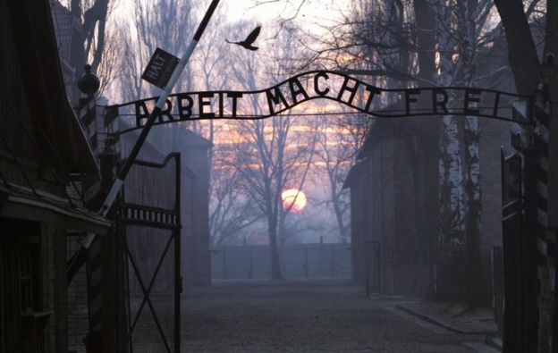 The main gates at the entrance to the Auschwitz I Nazi concentration camp in Oswiecim, Poland, pictured as the sun sets