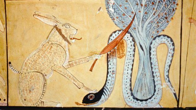 Бог Ра в образе кота побеждает Апофиса в образе змея