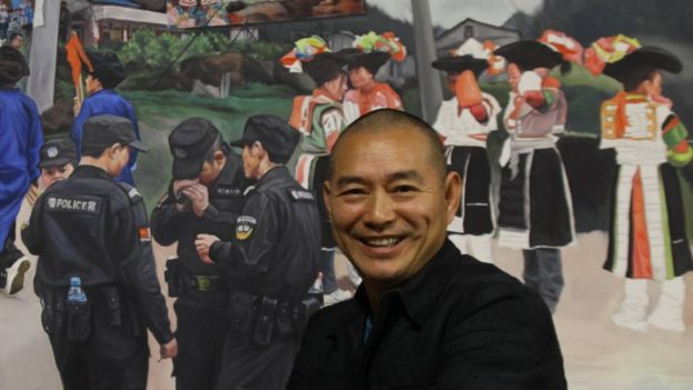 Guo Jian in front of one of his paintings