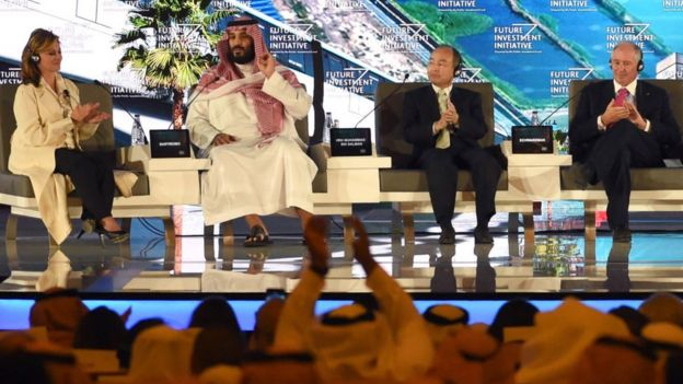 Saudi Crown Prince Mohammed bin Salman (2ND L), US journalist Maria Bartiromo (L), Masayoshi Son (3RD L), the Chief Executive Officer of SoftBank and Stephen Shwarzman, CEO of the Blackstone Group, attend the Future Investment Initiative (FII) conference in Riyadh, on 24 October 2017
