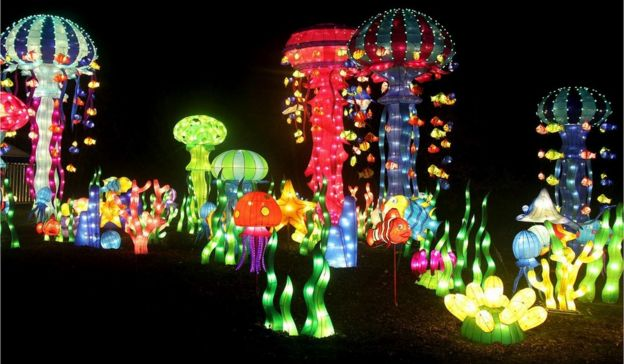 chinese christmas house chinese lantern festival lights up leeds roundhay park bbc news