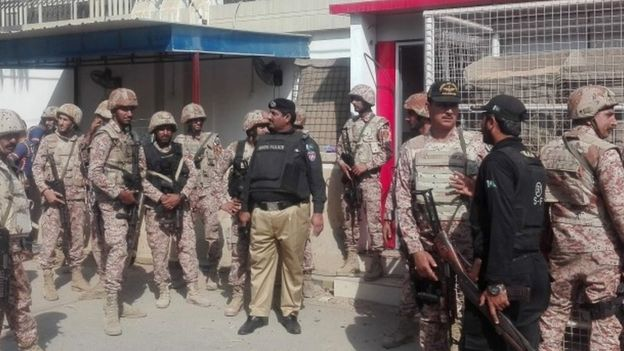 Pakistani security forces stand outside the Chinese consulate in Karachi
