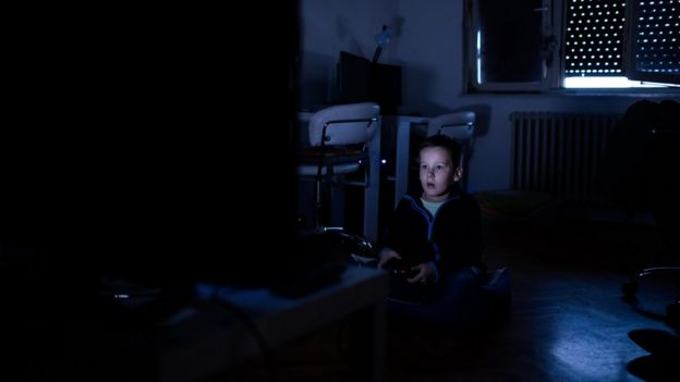 Boy playing a video game.
