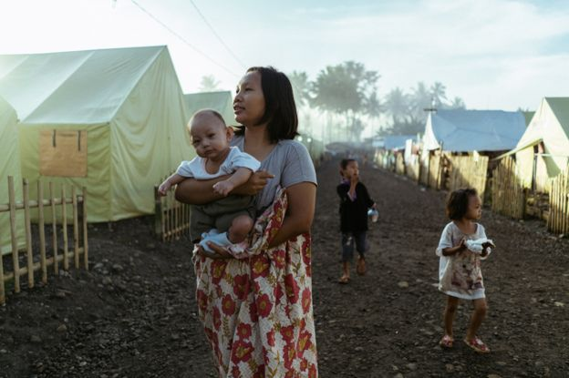100,000 people remain in camps
