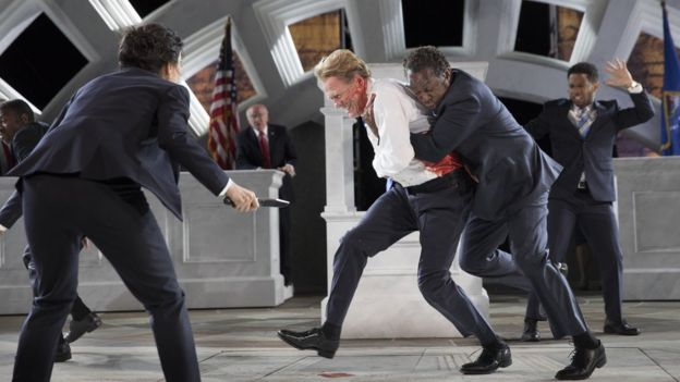 This production of Julius Caesar with Gregg Henry (centre) as Caesar at the Delacorte Theatre in New York in 2017 depicted the assassination of a Trump-like Roman rule