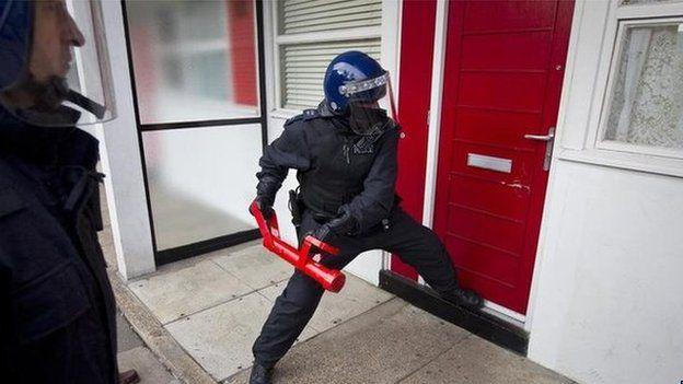 Generic police breaking down door