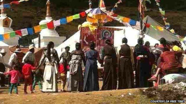File photo provided courtesy of Free Tibet reportedly shows Tibetans holding a prayer service for Tenzin Delek Rinpoche, 12 October 2014