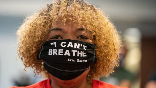 Gwen Carr, the mother of Eric Garner, wearing a protective mask attends New York Governor Andrew Cuomo's daily media briefing at the Office of the Governor of the State of New York on 12 June 2020 in New York City