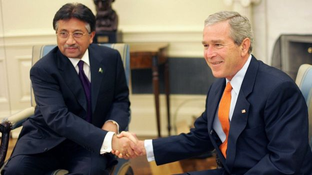 Musharraf and George W Bush shake hands in the Oval Office of the White House