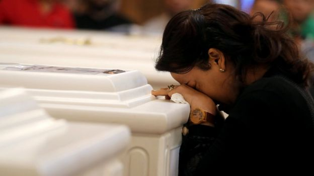 A relative of victims of an attack on a group of Coptic Christians attends a funeral, at the Prince Tadros Church in Minya, Egypt, November 3, 2018