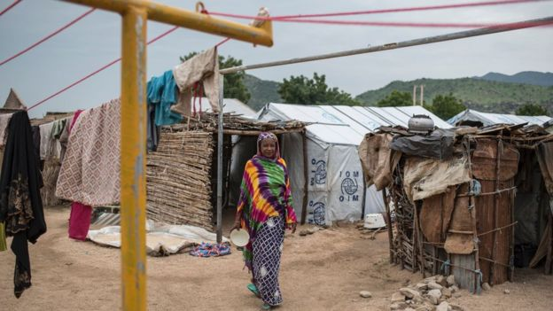 A woman walks through one of the Internally-Displaced People (IDP) camps in Gwoza, north-eastern Nigeria, on August 1, 2017.