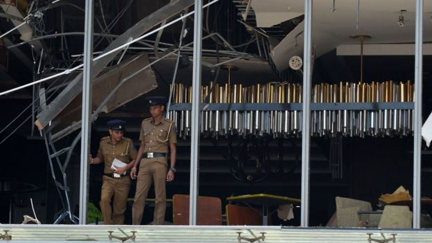 Sri Lankan police at the site of an explosion at the luxury Shangri-La hotel in Colombo.